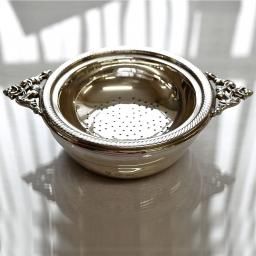 Double Handled Sterling Silver Tea Strainer and Bowl with Gold plated inside